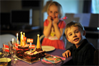 Ellen and Leo brace themselves for a feast of chocolate cake