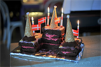 A princess castle with chocolate cake bricks and raspberry creme mortar.