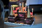 A princess castle with chocolate cake bricks and raspberry creme mortar.