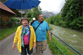 Mom and dad, on the walk into town (that river was really moving after a previous day of rain)