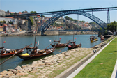 Rabelo boats on the Douro, with the Maria Pia bridge in the background, which was designed by Gustave Eiffel